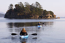 Four paddlers kayaking off of Orcas Island.