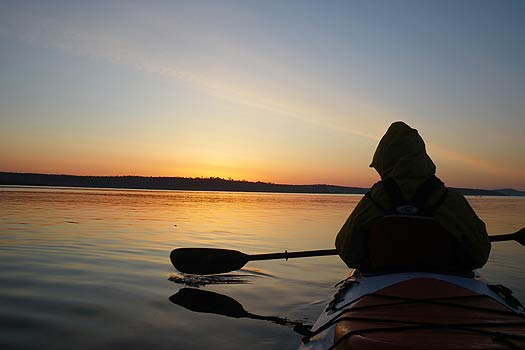 Tandem sea kayaking at sunrise.