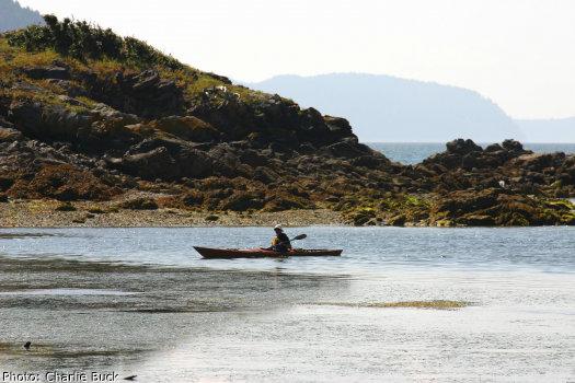 A solo sea kayaker off of Orcas Island, Washington State.