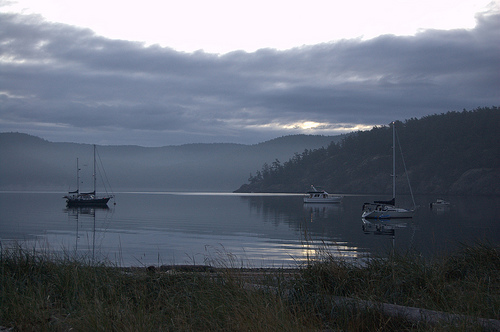 Sailboats and powerboats at anchor at Spencer spit State Park, Lopez Island.